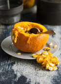 Hokkaido pumpkin being hollowed out