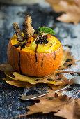 Pumpkin cream soup in a pumpkin bowl