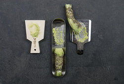 Three types of wasabi with a sharkskin grater and metal graters