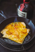 Crepe Suzette in a cast iron pan