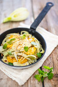 Fennel gratin with oranges in a pan