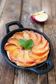 Small Apple Tarte Tatin in a cast iron pan