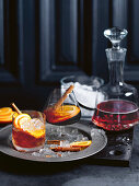 Port wine punch with cinnamon and oranges