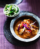 Chicken Tikka Masala with red onion, paprika and coleslaw