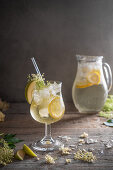 Elderflower cordial with lemon and apple slices on ice