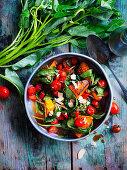 Kürbis, Tomaten und Wasserspinat aus dem Wok