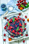 Summer fruit tart with berries, apricots and cherries