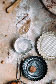 Unbaked gingerbread biscuits with baking ingredients