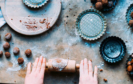 Child rolling out dough for gingerbread biscuits for St. Nicholas Day