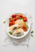 Scamorza filled with anchovies, served with tomatoes
