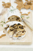 Stollen with icing sugar, sliced