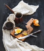 Black bread toasts with tangerine marmelade and mascarpone cheese and fresh coffee