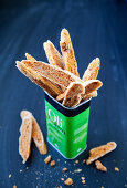 Tomato bread sticks in a metal box
