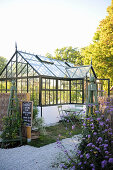 A greenhouse in a large garden