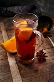 Spiced cider with an orange slice and star anise