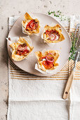 Pasta baskets with caramelised tomatoes, burrata and breadcrumbs