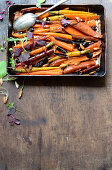 Roast sweet potato and carrot tzimmes with sour cherries and sticky orange syrup