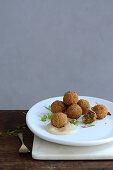 Deep-fried herb matzo balls with tahini sauce