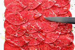 Beef fillet carpaccio being made