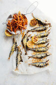 Sardines stuffed with kale, pine nuts and raisin