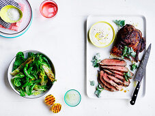 Barbecued butterflied lamb leg with saltbush rub - Charred lettuce and pea salad with lemon dressing