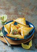 Sardine triangles with avocado dip