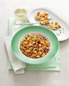 Gemelli with rabbit ragout and croutons
