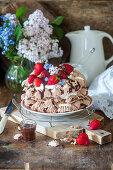 Chocolate meringue cake with fresh strawberries