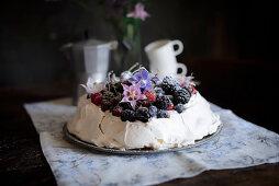 Pavlova with berries and cherries