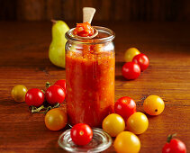 Homemade tomato chutney with pear, ginger, vinegar, cherry tomatoes, chili, cilantro, cloves and thyme