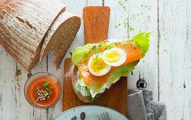 An open salmon sandwich with egg