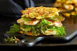 A veggie burger with halloumi and lettuce