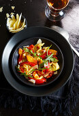 Ravioli with tomatoes and carrots