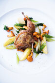 Sautéed quail with chanterelle mushrooms and young onions