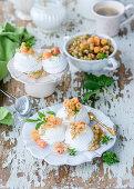Mini pavlovas with white currants and white raspberries
