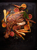Oven roast turkey with carrots and blood oranges