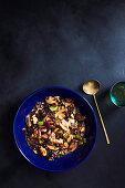 Miso glazed mushrooms with walnuts and black barley