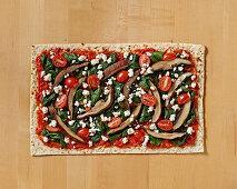 Flatbread Spinach and Portabella Mushroom Pizza on Butcher Block Table