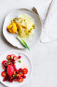 Strawberry, cherry and raspberry sorbet - Pineapple carpaccio with mango sorbet