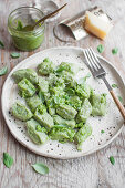 Broad bean dumplings with basil pesto and grated parmesan