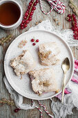 White and red currant cake with meringue toppingwith cup of tea