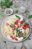 Pasta caprese - pasta with fresh tomatoes, basil, mozzarella and olive oil