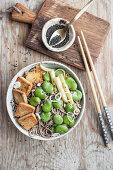 Yaki soba (Stir fry with soba noodles) with fried tofu, broad beans, french beans, spring onion and black sesame
