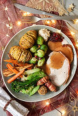 A Christmas turkey with bacon, vegetables and Hasselback potatoes