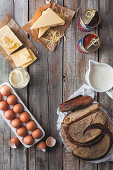 A loaf of bread, eggs, dairy products and a tin of tomatoes