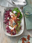 Cobb salad (radicchio, chicory) with roasted, corn-fed chicken, blue cheese and bacon in a maple syrup dressing