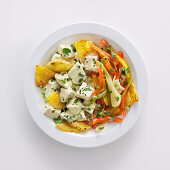 Chicken breast in a herby mayonnaise sauce with spring onions, pineapple and peppers