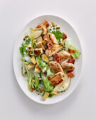 Chicken breast with pears, almonds and gorgonzola sauce