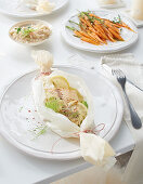 A fish parcel with fennel, lemon butter, carrots and risotto for Christmas