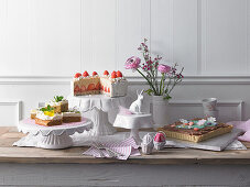 Easter cake buffet with caramel and strawberry cake, almond nougat tart and carrot cake